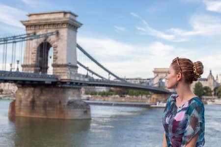 Young woman posing at Szechenyi Chain Bridge at Budapest, Hungary