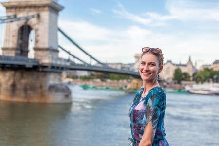 Young natural redhead woman smiling at Danube, Budapest, Hungary
