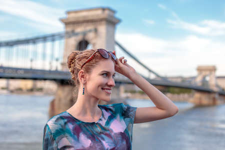 Young urban woman smiling in city Budapest, Hungary