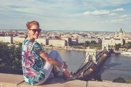 Redhead Caucasian 20s woman toothy smile at Budapest panorama, Hungary 免版税图像