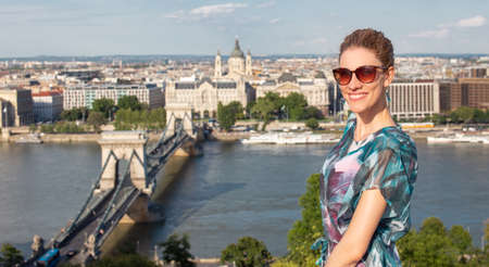 Happy young redhead Caucasian 20s woman with toothy smile at Budapest panorama, Hungary