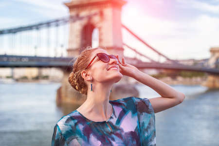 Young woman looking up during sightseeing in sunrise in Budapest, Hungary
