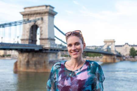 Young natural redhead woman smiling at Chain bridge, Budapest, Hungary 免版税图像