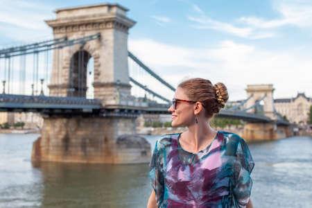 Happy young balanced woman enjoying sightseeing at Budapest, Hungary