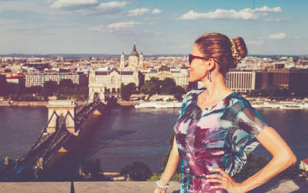 Happy young redhead Caucasian 20s woman profile view at Budapest panorama, Hungary