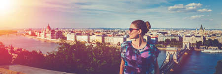 Happy young redhead woman wondering in Budapest sunset panorama, Hungary 免版税图像