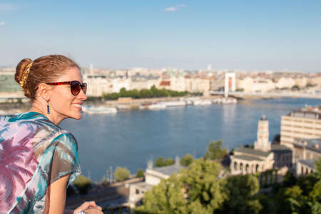 Young urban woman wondering in city panorama Budapest, Hungary