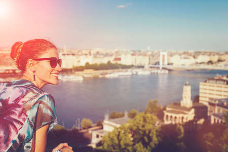 Young urban woman in sunset wondering in city panorama Budapest, Hungary