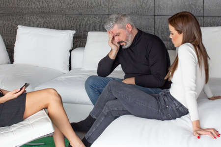 Sad man got headache on couple therapy at psychologist