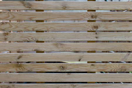 Parallel wooden slats texture. Element of decor. Wood background, close up