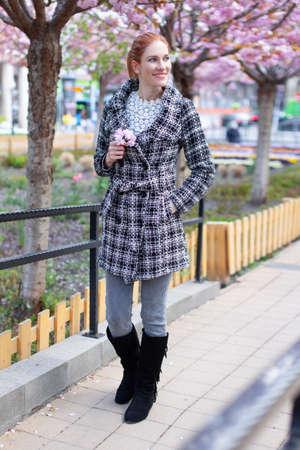 Young woman enjoying walking at park during Sakura, full body 版權商用圖片