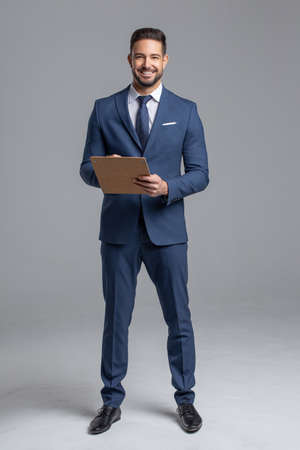 Happy young confident Caucasian manager with clipboard on gray background