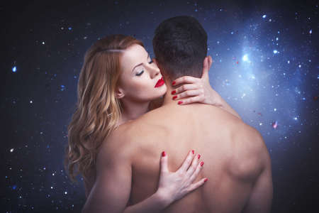 Passionate blonde woman embracing man in heaven, eyes closed