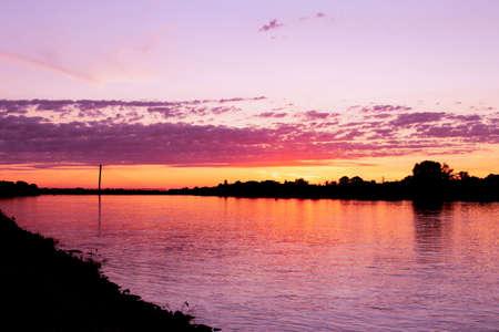 Colorful purple sunrise at riverbank of Danube, Komarom, Hungary