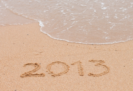2013 year on sand background.Details sand. photo