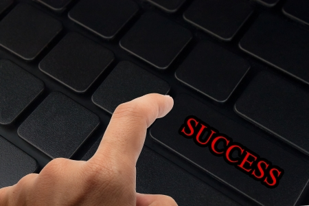success in business concept with key on computer keyboard. photo