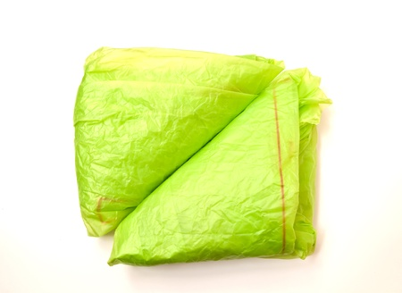 reusing: Green plastic bags on a white background