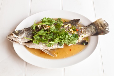 Steamed snapper fish with lemon ,spicy food photo