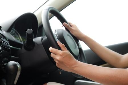 Vrouw besturen van een auto Stockfoto - 20100353