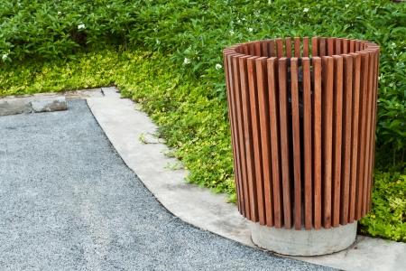 developed: Wood trash bin in green park Stock Photo