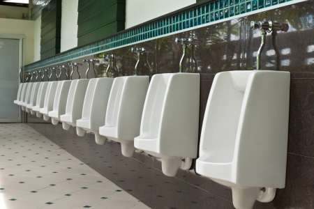 line of white urinals in public toilets Stock Photo - 22522307