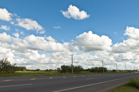 telegraphs: wire pole inside road on countryside withe blue sky