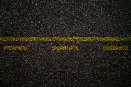 interrupted: Asphalt road texture,yellow line on road Stock Photo