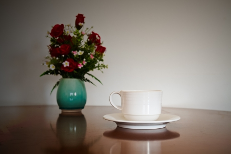 Coffee cup on grunge wooden table photo