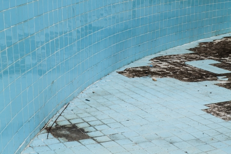 Abandoned swimming pool,old blue swimming pool photo