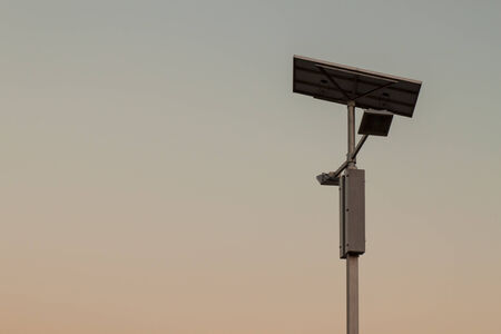 Electricity post and Solar cells on sky. photo