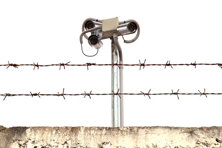 CCTV cameras in barbed wire fence. photo