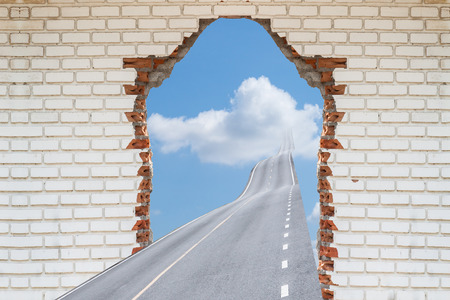 tearing down: highway going through a broken brick wall,.  Concepts for Success