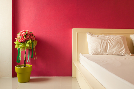 Decoration artificial flower in red bedroom photo