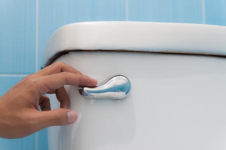 toilet with a flush. Press and flush. Standard-Bild