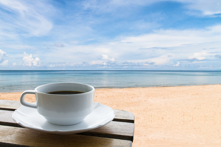 coffee cup on the beach background Stok Fotoğraf