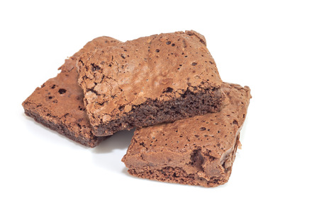 Pile of brownies isolated on white photo