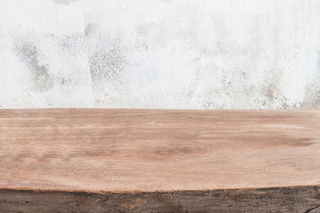 Empty wooden table over grunge wall, vintage background