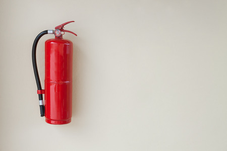 chemical hazard: Fire Extinguisher  on wall