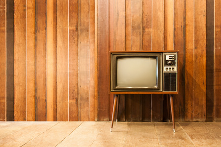 retro: Old vintage television or tv in room Stock Photo