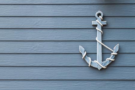 wooden anchor on wall background Standard-Bild