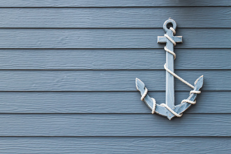 wooden dock: wooden anchor on wall background Stock Photo