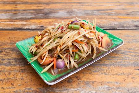 tam: Green Papaya Salad on wood table  SOM TAM