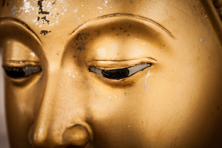 closeup eyes golden buddha