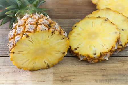 Pineapple slices on wood table