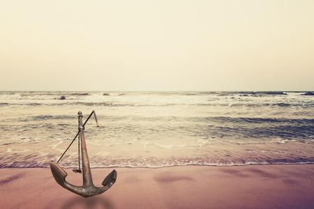 anchor on sand with sea,in vintage style