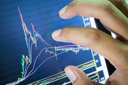 stock market: businessman and stock market graph and bar chart price display,Businessman failure in stock market