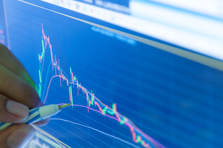 businessman and stock market graph and bar chart price display,Businessman failure in stock market,in blue style photo