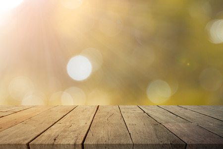 empty wooden table for product display with sunlight bokeh  background
