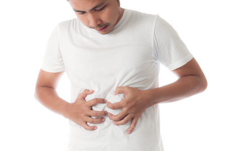 asian man in white t-shirt suffering from stomachache