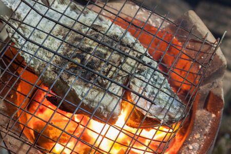 nile tilapia: Nile Tilapia Fish grilled on charcoal stove Stock Photo